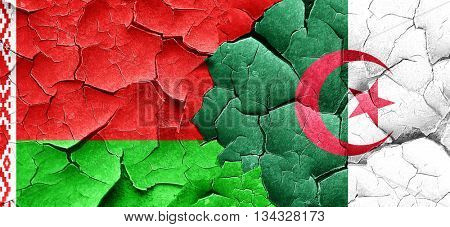 Belarus flag with Algeria flag on a grunge cracked wall