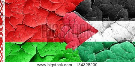 Belarus flag with Palestine flag on a grunge cracked wall