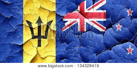 Barbados flag with New Zealand flag on a grunge cracked wall