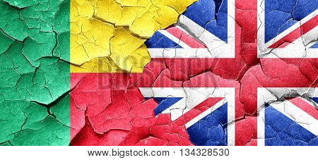 Benin flag with Great Britain flag on a grunge cracked wall