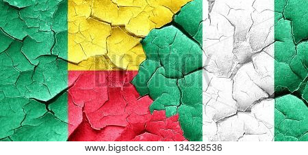 Benin flag with Nigeria flag on a grunge cracked wall