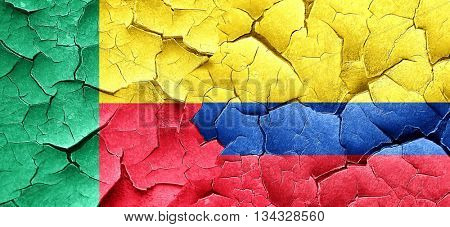 Benin flag with Colombia flag on a grunge cracked wall
