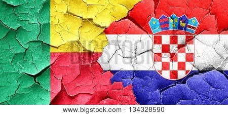 Benin flag with Croatia flag on a grunge cracked wall