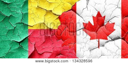 Benin flag with Canada flag on a grunge cracked wall