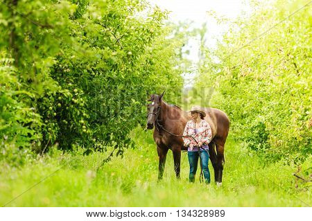 Western Cowgirl Woman With Horse. Sport Activity