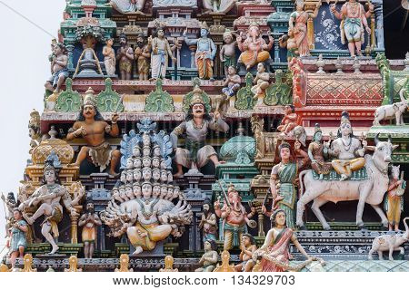 Chettinad India - October 17 2013:Detail of the Shiva temple gopuram at Kottaiyur shows Lord Shiva as Maha Sadashiva Murthy with 25 heads. Dancing Shiva too and many colorful statues.