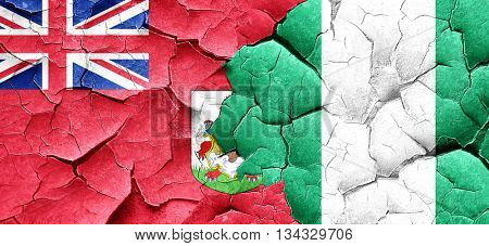 bermuda flag with Nigeria flag on a grunge cracked wall