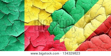 Benin flag with congo flag on a grunge cracked wall