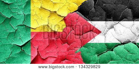 Benin flag with Palestine flag on a grunge cracked wall