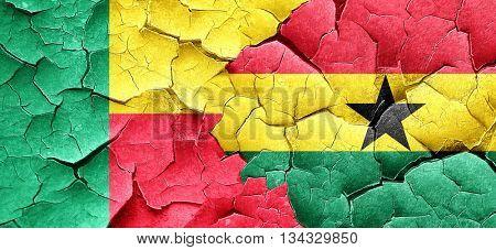 Benin flag with Ghana flag on a grunge cracked wall
