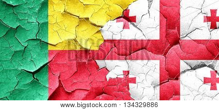 Benin flag with Georgia flag on a grunge cracked wall