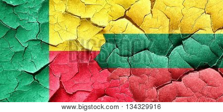 Benin flag with Lithuania flag on a grunge cracked wall