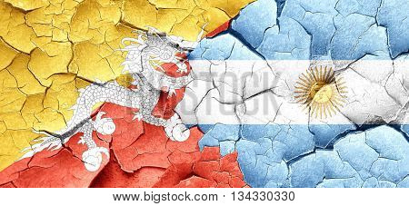 Bhutan flag with Argentine flag on a grunge cracked wall