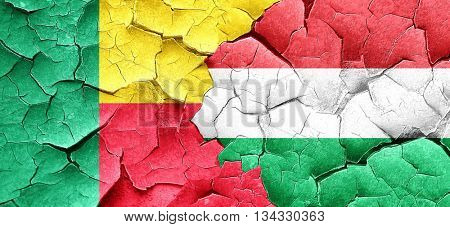 Benin flag with Hungary flag on a grunge cracked wall