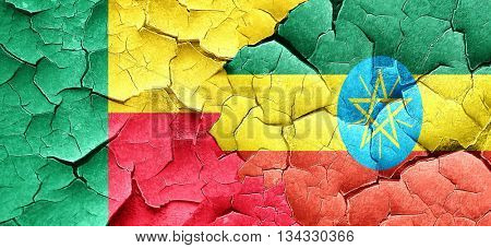 Benin flag with Ethiopia flag on a grunge cracked wall