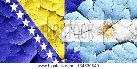Bosnia and Herzegovina flag with Argentine flag on a grunge crac