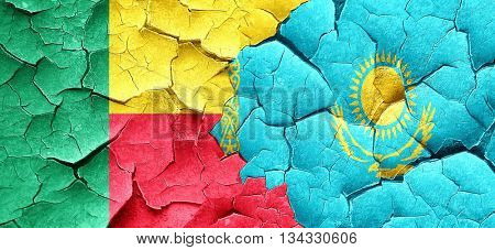 Benin flag with Kazakhstan flag on a grunge cracked wall
