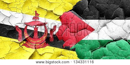Brunei flag with Palestine flag on a grunge cracked wall