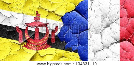 Brunei flag with France flag on a grunge cracked wall
