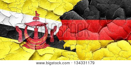Brunei flag with Germany flag on a grunge cracked wall