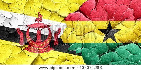 Brunei flag with Ghana flag on a grunge cracked wall