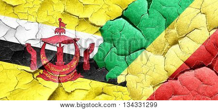 Brunei flag with congo flag on a grunge cracked wall