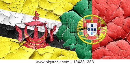 Brunei flag with Portugal flag on a grunge cracked wall