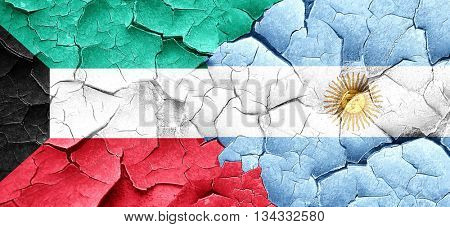 Kuwait flag with Argentine flag on a grunge cracked wall