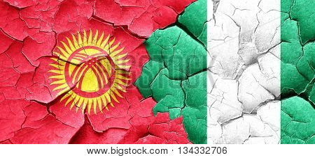 Kyrgyzstan flag with Nigeria flag on a grunge cracked wall