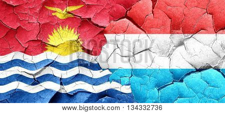 Kiribati flag with Luxembourg flag on a grunge cracked wall