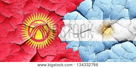 Kyrgyzstan flag with Argentine flag on a grunge cracked wall