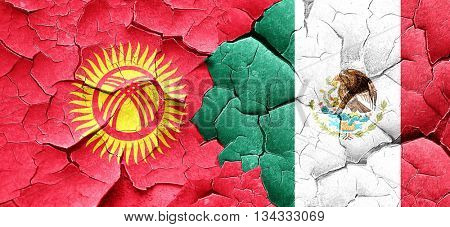 Kyrgyzstan flag with Mexico flag on a grunge cracked wall