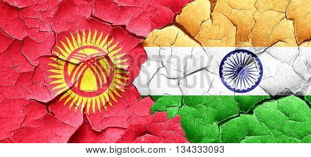 Kyrgyzstan flag with India flag on a grunge cracked wall