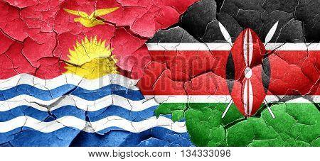Kiribati flag with Kenya flag on a grunge cracked wall