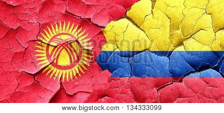Kyrgyzstan flag with Colombia flag on a grunge cracked wall