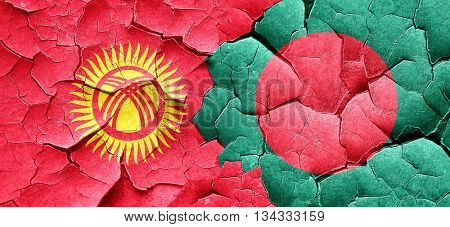 Kyrgyzstan flag with Bangladesh flag on a grunge cracked wall