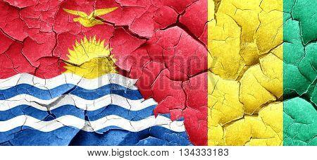 Kiribati flag with Guinea flag on a grunge cracked wall