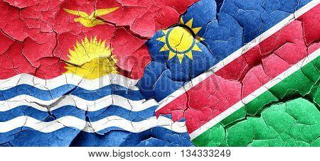 Kiribati flag with Namibia flag on a grunge cracked wall