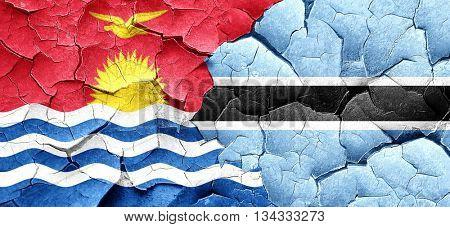 Kiribati flag with Botswana flag on a grunge cracked wall