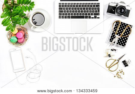 Business still life. Feminine home office desk. Coffee and colorful macaroon cookies. Flat lay. Hero header for social media