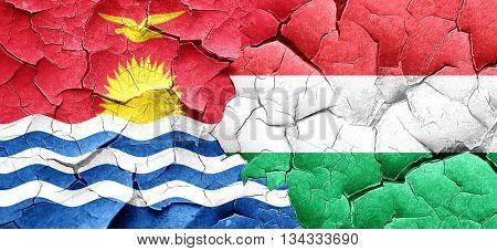 Kiribati flag with Hungary flag on a grunge cracked wall