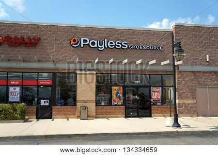 SHOREWOOD, ILLINOIS / UNITED STATES - AUGUST 16, 2015: One may purchase shoes at the Payless Shoe Source, in a Shorewood strip mall.