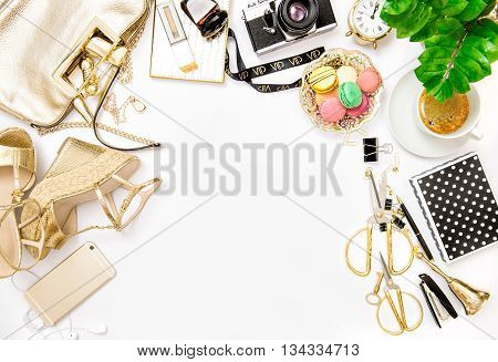 Fashion flat lay for bloggers social media. Feminine accessories bag shoes office supplies vintage no name photo camera and green plant on white background