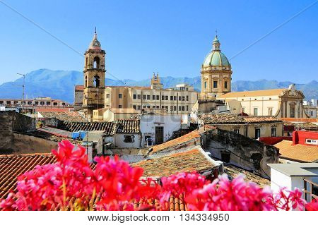 View Over The Rooftops And Churches Of Palermo, Sicily With Vibrant Flowers