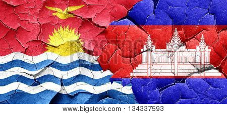 Kiribati flag with Cambodia flag on a grunge cracked wall