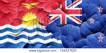 Kiribati flag with New Zealand flag on a grunge cracked wall