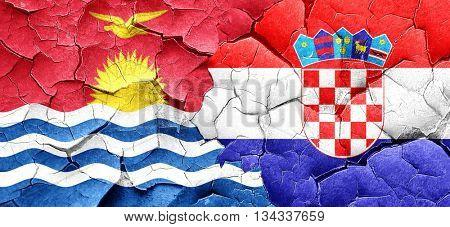 Kiribati flag with Croatia flag on a grunge cracked wall