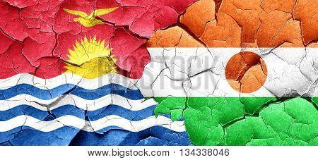 Kiribati flag with Niger flag on a grunge cracked wall