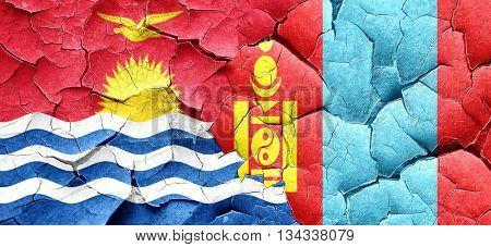 Kiribati flag with Mongolia flag on a grunge cracked wall