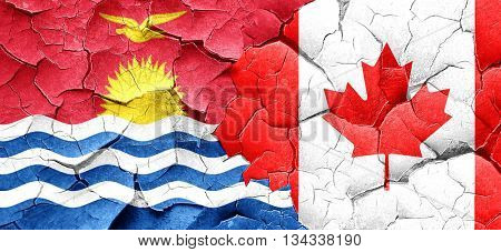 Kiribati flag with Canada flag on a grunge cracked wall